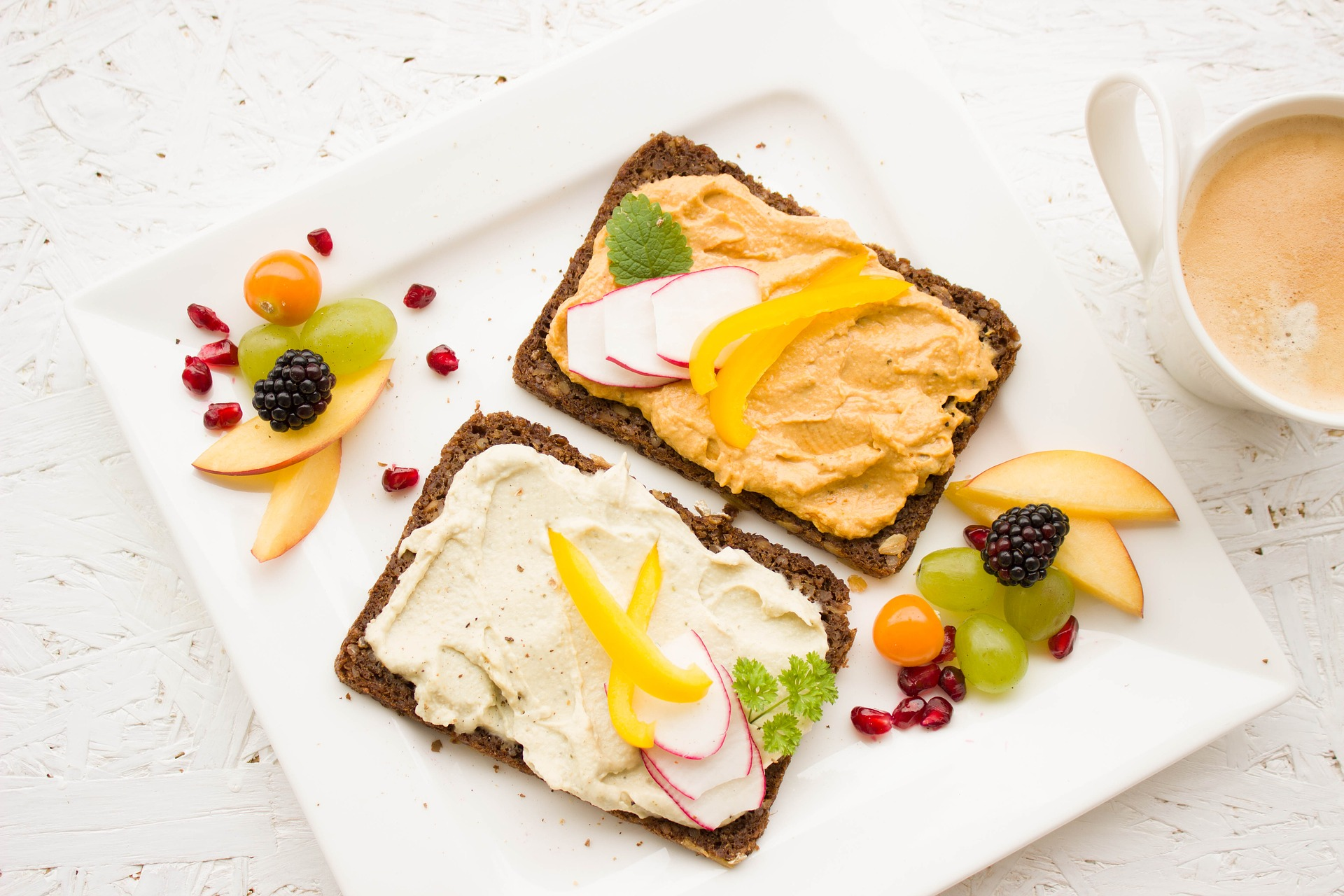 breakfast toast on white plate with fruit
