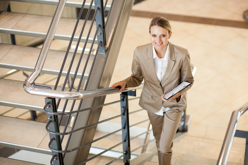 business woman taking stairs